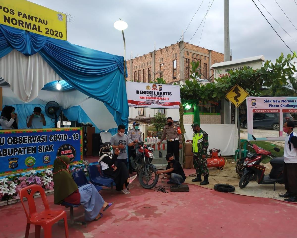 Meriahkan Hari Bhayangkara ke 74, Polres Siak Mengadakan Bengkel Gratis di Pos Pantau New Normal Kampung Tengah Maredan
